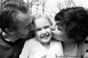 Parents kiss their daughter on the cheek. Also liked this in black & white.